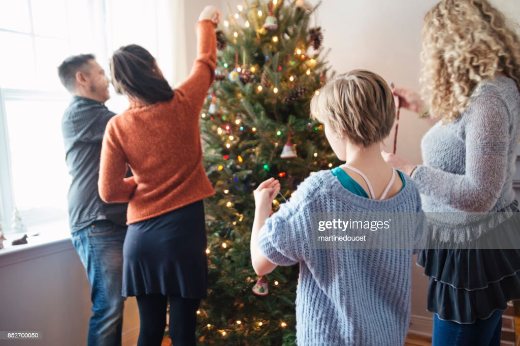 Family decorating Christmas tree at home. : Stock Photo