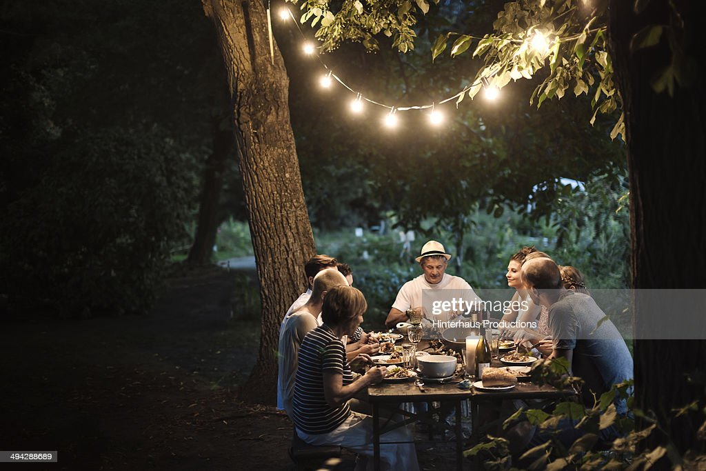 Family Dinner At The Garden : Stock Photo