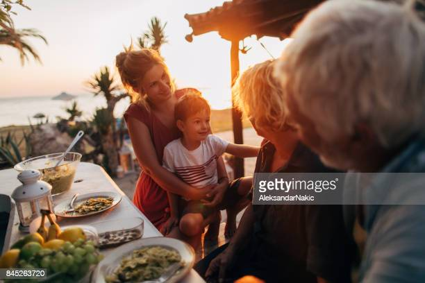Family dinner by the sea
