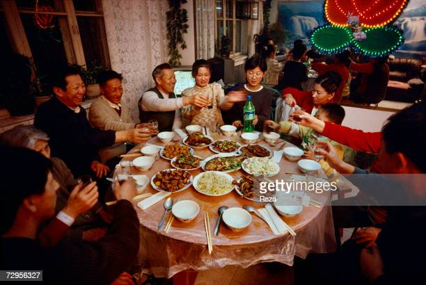 Family dinner for the celebration of the Chinese New Year on February 1999 in Heihe China