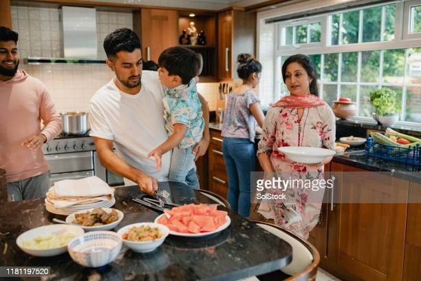 family dinner - multi ethnic group stock pictures, royalty-free photos & images