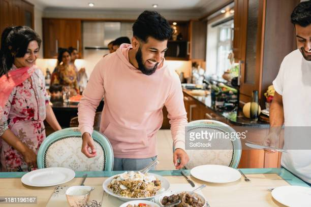 family dinner time - meal stock pictures, royalty-free photos & images