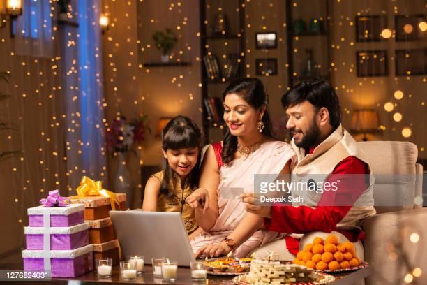 family diwali celebrate - stock photo - diwali stock pictures, royalty-free photos & images