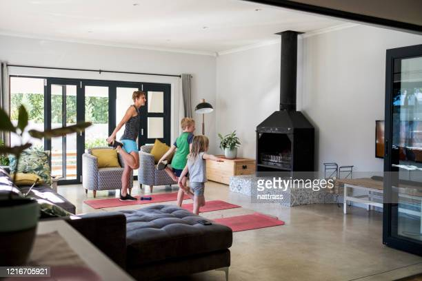 family doing an online fitness class at home - home workout stock pictures, royalty-free photos & images