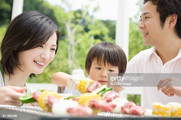 Family doing barbecue