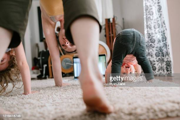 family doing home workout online class - home interior stock pictures, royalty-free photos & images
