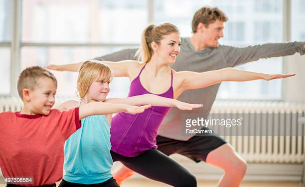 Family Doing Warrior Yoga Pose