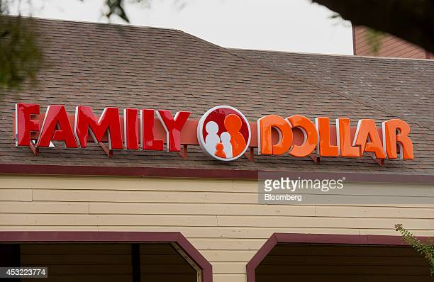 Family Dollar Stores Inc signage is displayed at a location in Davis California US on Tuesday Aug 5 2014 Dollar General Corp is weighing a bid for...