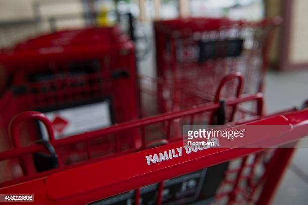 Family Dollar Stores Inc signage is displayed on a shopping cart at a location in Davis California US on Tuesday Aug 5 2014 Dollar General Corp is...