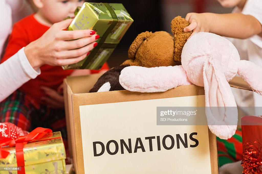Family donating gifts and toys to charity for Christmas holiday : Stock Photo