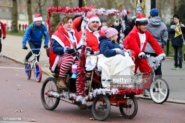 A family dressed as Father Christmas are seen on Horse Guards Parade before taking part in an event to raise awareness and money for Evelina London...