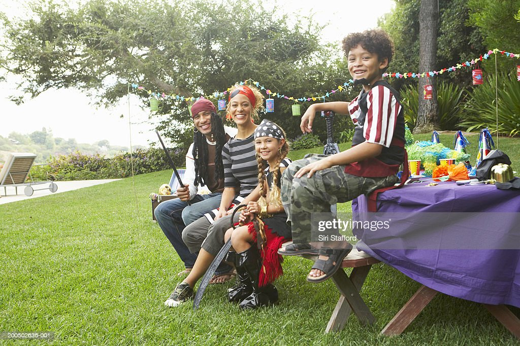 Family dressed in pirate costumes : Stock Photo