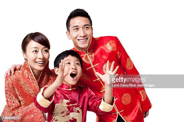 Family Dressed in Traditional Clothing  Celebrating Chinese New Year