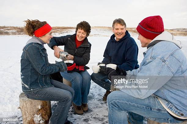 family drinking hot cocoa - hot women pics ストックフォトと画像