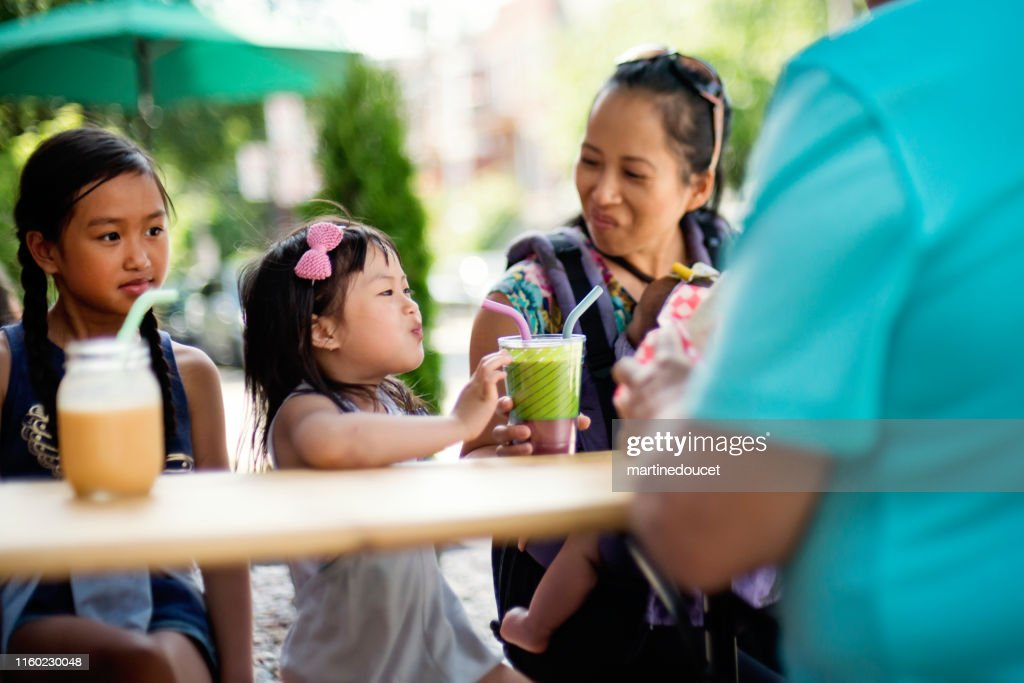 Family drinking smoothies in reusable glass with reusable straw. : Stock Photo