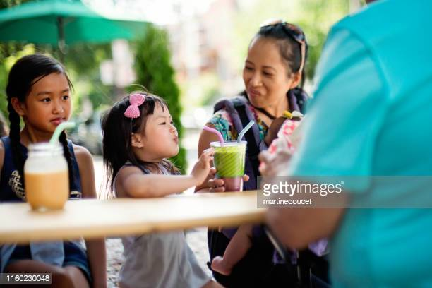 """family drinking smoothies in reusable glass with reusable straw. - """"martine doucet"""" or martinedoucet stock pictures, royalty-free photos & images"""