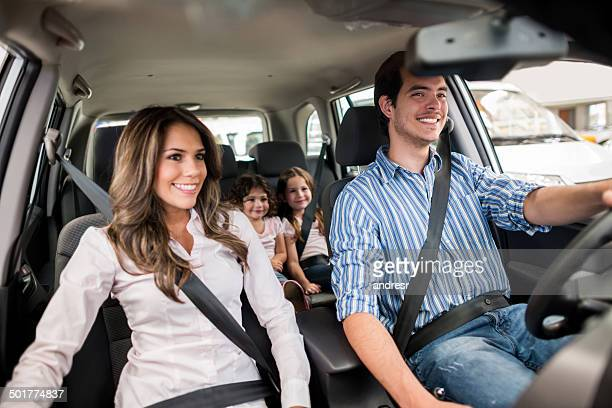Family driving a car