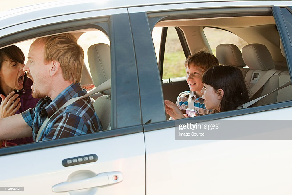 Family driving in car, parents shouting at children : Stock Photo