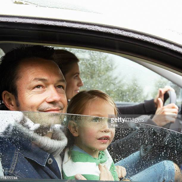Family Driving in the Rain