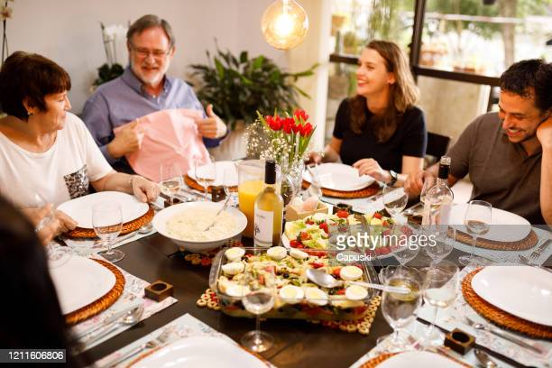 family easter lunch - easter dinner stock pictures, royalty-free photos & images
