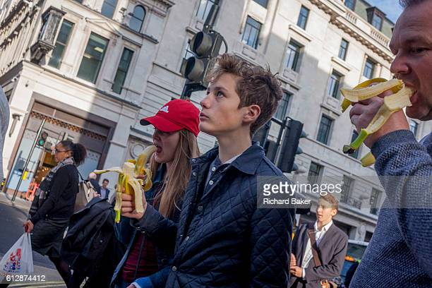 A family eat healthy energygiving bananas while visiting central London on 29th September 2016 in central London England Bananas contain high levels...