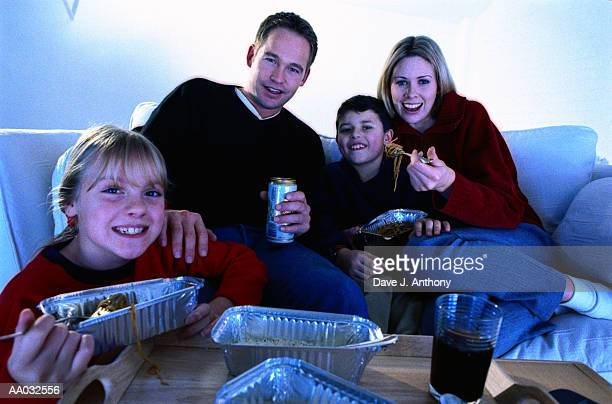 Family Eating and Watching Television