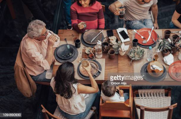 family eating at a mexican restaurant - mexican beer stock pictures, royalty-free photos & images