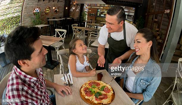 Family eating at an Italian restaurant