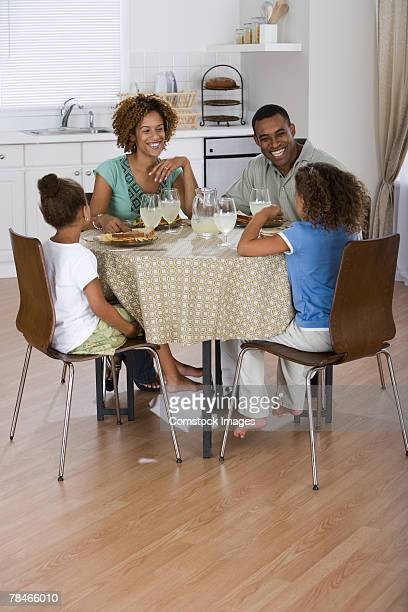 Family eating at kitchen table together