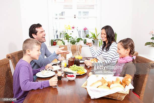 Family eating breakfast at table