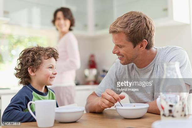 Family eating breakfast in kitchen