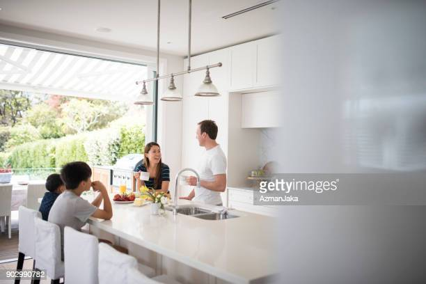 family eating breakfast in the kitchen - home interior stock pictures, royalty-free photos & images