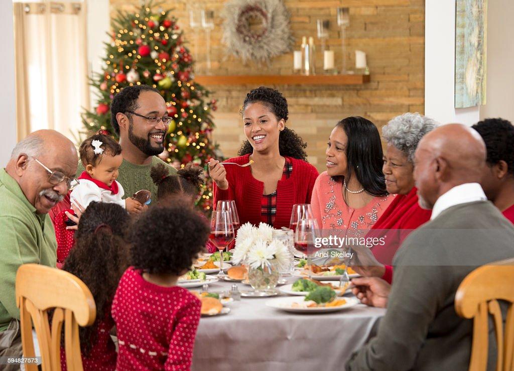 Family Eating Christmas Dinner Stock Photo