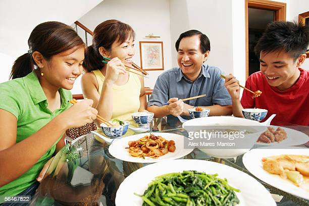 Family eating dinner at home