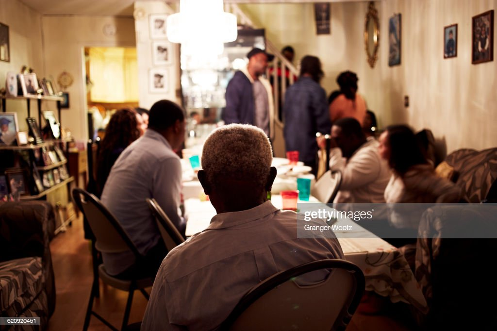 Family eating dinner at table : Stock Photo