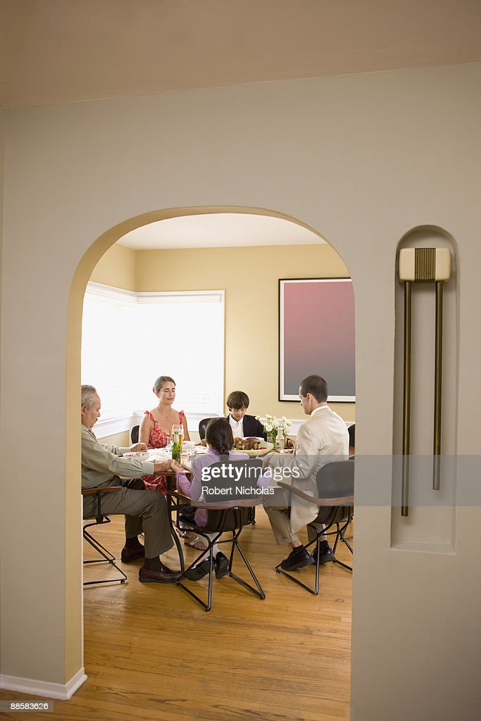 Family Eating Dinner In Dining Room Stock Photo | Getty Images