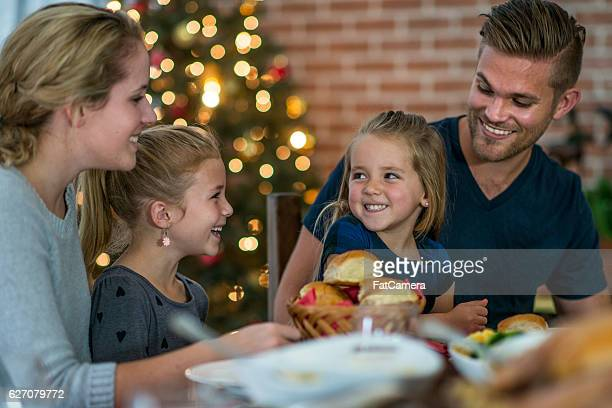 Family Eating Dinner Together on Christmas Eve