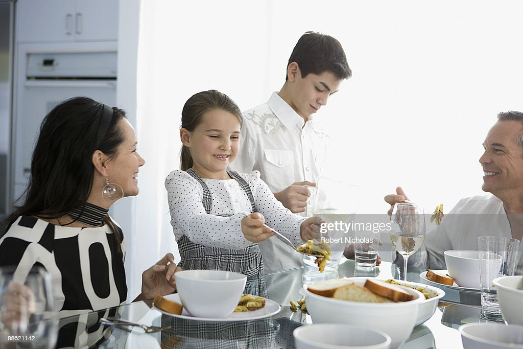 Family Eating Dinner Together Stock Photo