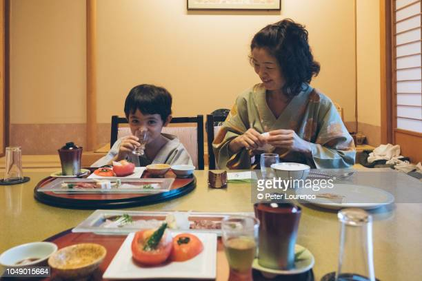 Family eating food in Japanese Ryokan