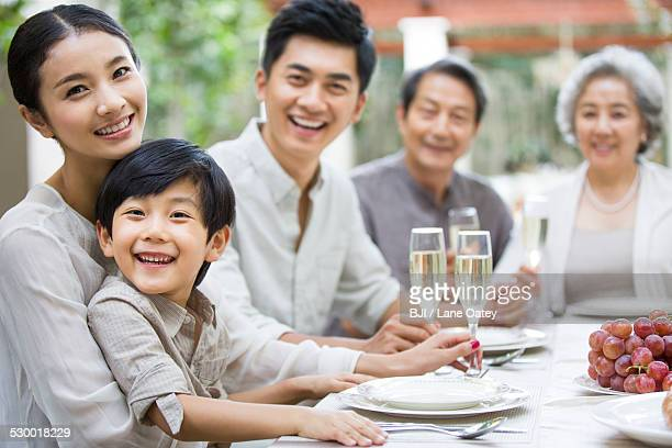 Family eating holiday meal together