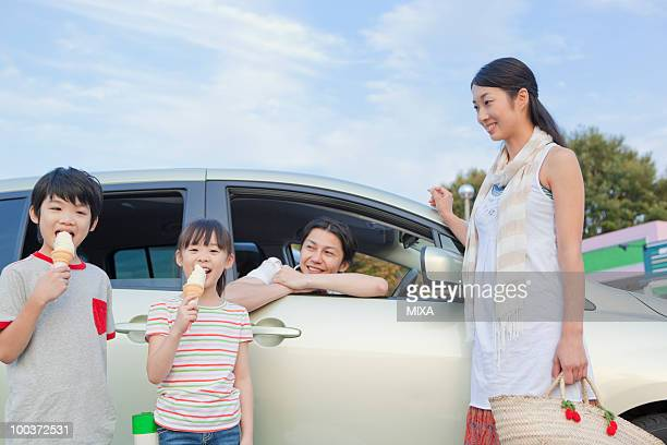 Family Eating Ice Cream at Service Area
