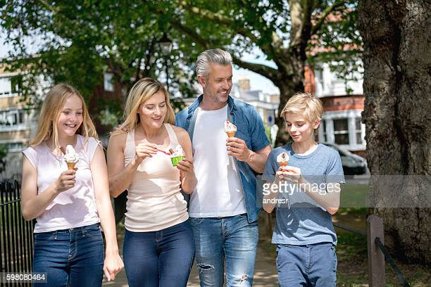 Family eating ice cream at the park