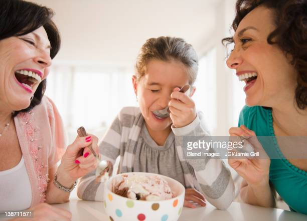 family eating ice cream together - indulgence stock pictures, royalty-free photos & images