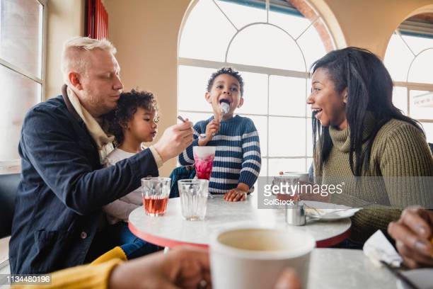 family eating in a cafe - whitley bay stock pictures, royalty-free photos & images
