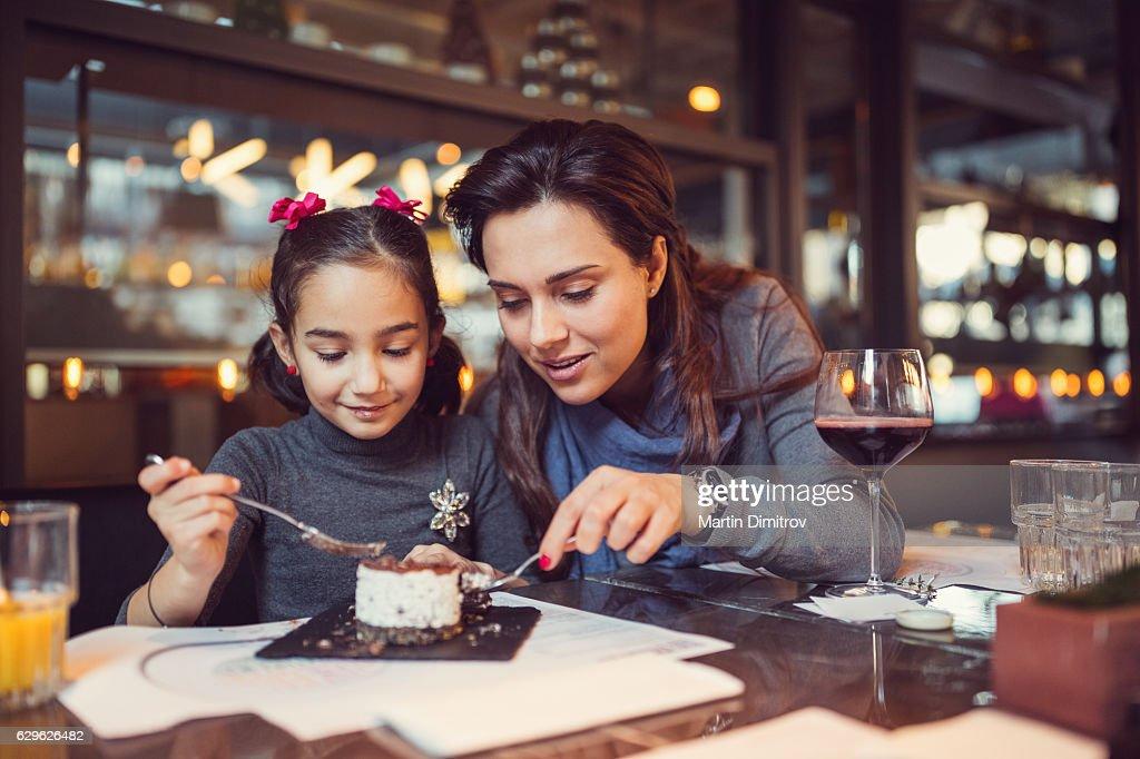 Family eating in restaurant : Stock Photo