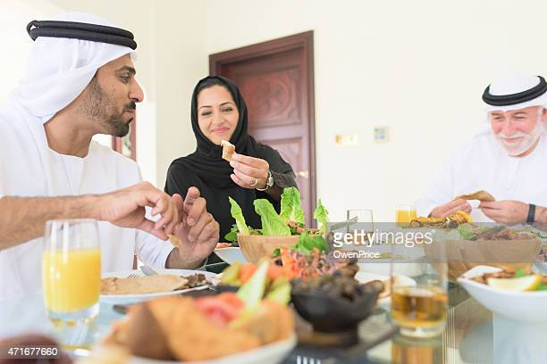 Family eating lunch at a dining table