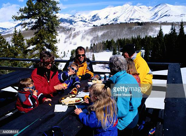 Family Eating Lunch at the Top of a Mountain