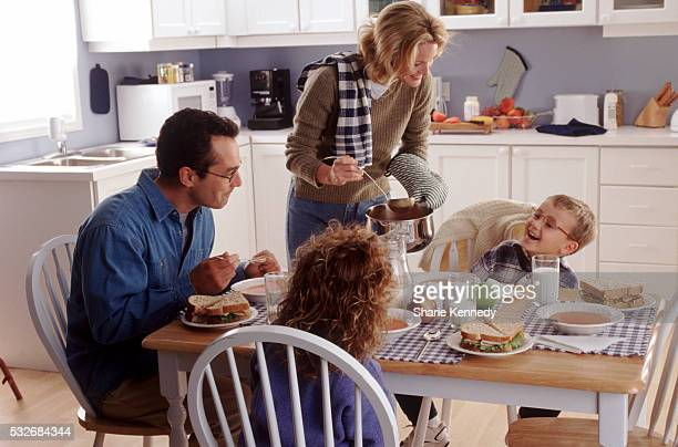 Family eating lunch in the kitchen