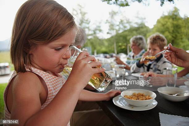 Family eating lunch outside at table