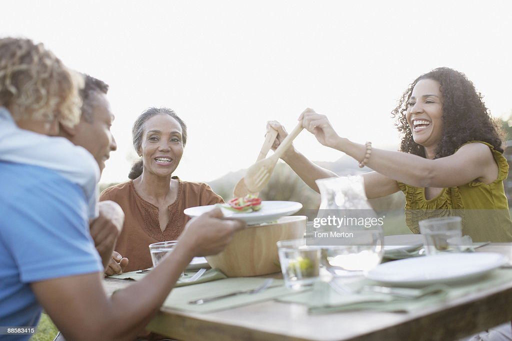 Family eating outdoors : Stock Photo